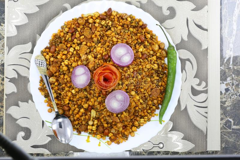 INDIAN NAMKEEN PEANTU DAL CHANA MIXTURE. Indian namkeen snacks lahsun gathiya spices crunchy white bowl background flavour fried oil stock image