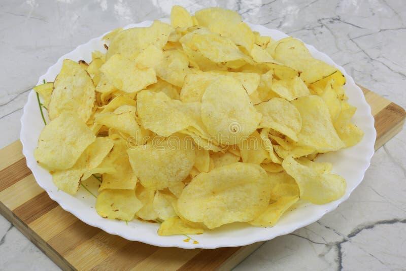 INDIAN NAMKEEN SNACKS GATHIYA BESAN. Indian namkeen snacks lahsun gathiya spices crunchy white bowl background flavour fried oil stock photo