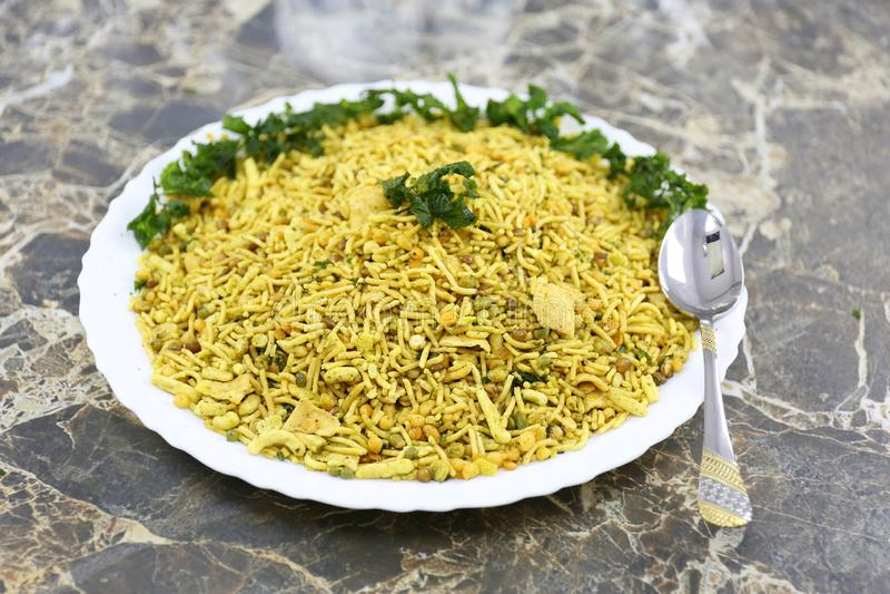 INDIAN NAMKEEN SNACKS GATHIYA BESAN. Indian namkeen snacks lahsun gathiya spices crunchy white bowl background flavour fried oil stock photography