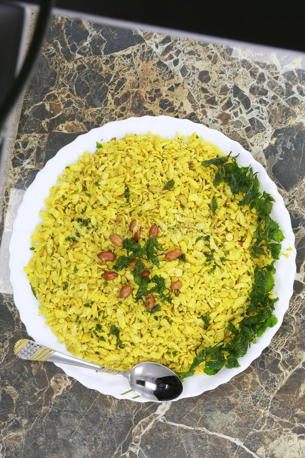 INDIAN NAMKEEN SNACKS GATHIYA BESAN. Indian namkeen snacks lahsun gathiya spices crunchy white bowl background flavour fried oil royalty free stock photo