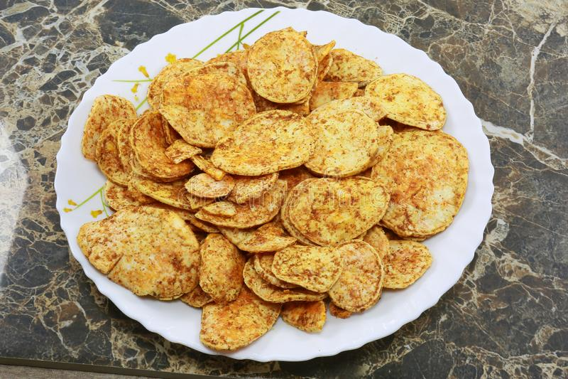 INDIAN NAMKEEN SNACKS GATHIYA BESAN. Indian namkeen snacks lahsun gathiya spices crunchy white bowl background flavour fried oil royalty free stock photos