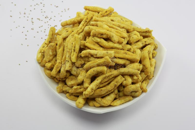 INDIAN NAMKEEN SNACKS GATHIYA BESAN. Indian namkeen snacks lahsun gathiya spices crunchy white bowl background flavour fried oil stock image
