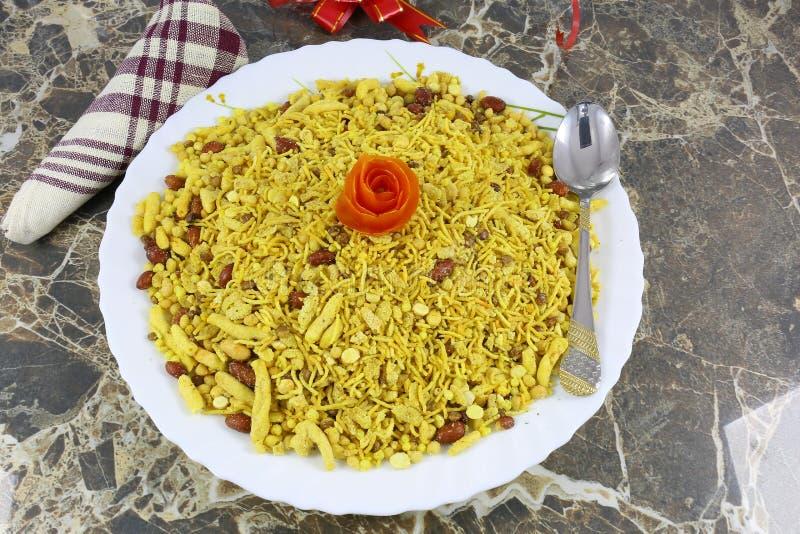INDIAN NAMKEEN TEEKHA MIXTURE SNACKS. Indian namkeen snacks lahsun gathiya spices crunchy white bowl background flavour fried oil royalty free stock photos