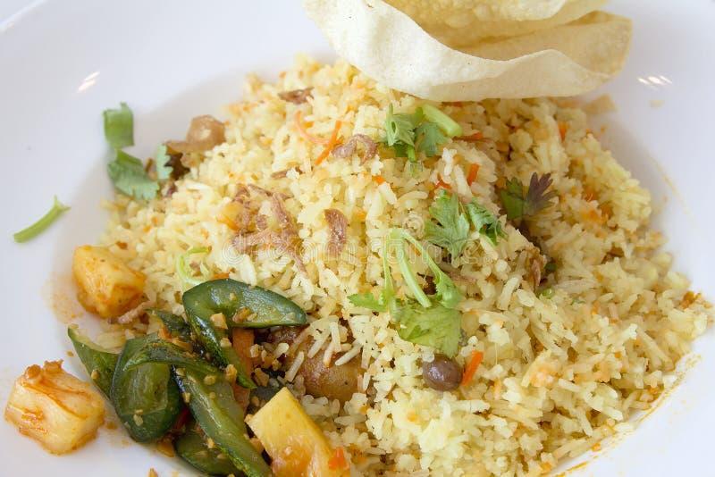Indian Nasi Briyani Rice Dish Closeup. Indian Nasi Briyani Rice Dish with Pickled Vegetable and Crackers Local Dish Closeup stock photography