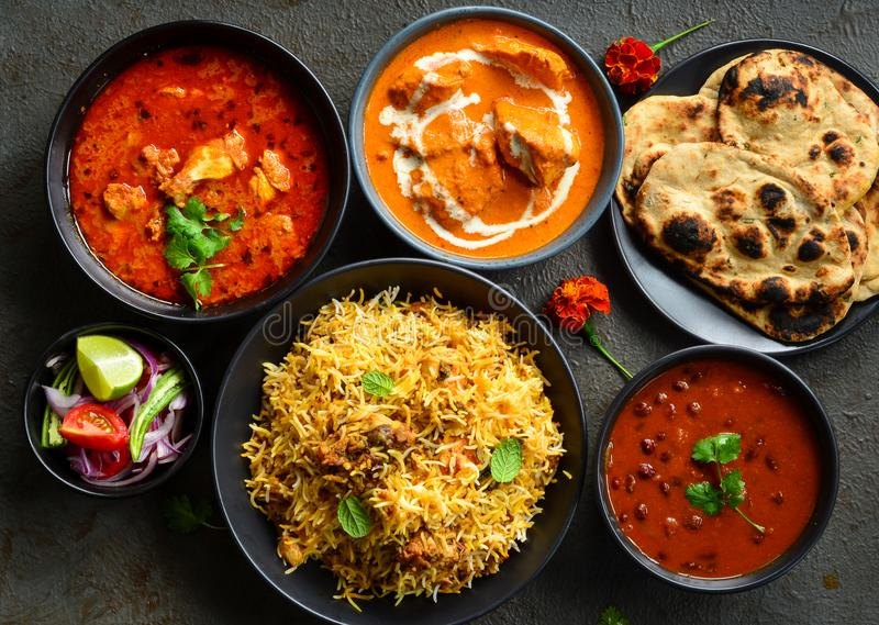 Indian non-vegetarian Meal -Punjabi platter. Indian meal consisting of butter chicken curry,Rajma masala,chicken curry,chicken biryani, along with Indian royalty free stock images