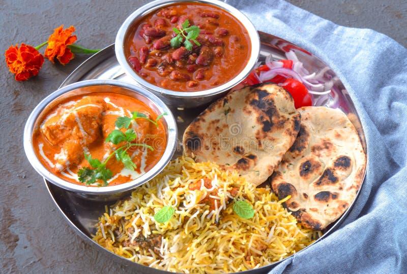 Indian non-vegetarian Meal -Punjabi platter. Indian Punjabi meal consisting of butter chicken curry,Rajma masala,chicken biryani, along with Indian flatbread royalty free stock photo