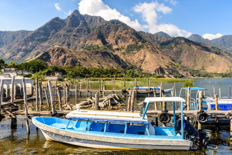 Indian Nose National Park & boats at San Juan la Laguna dock, Lake Atitlan, Guatemala royalty free stock photo