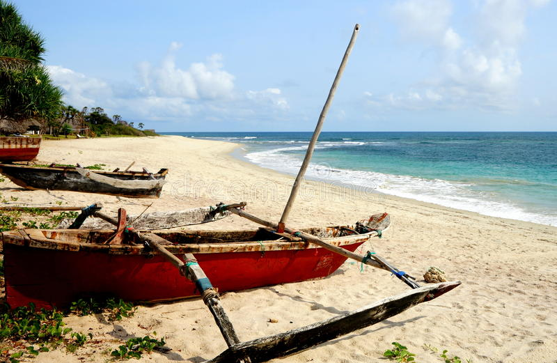 Indian Ocean. Some dugouts on an Indian Ocean beach approximately 30 km (20 miles) south of Dar es Salaam, Tanzania stock image