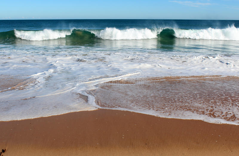 Indian Ocean waves rolling in at pristine Binningup Beach Western Australia on a sunny morning in late autumn. royalty free stock photo