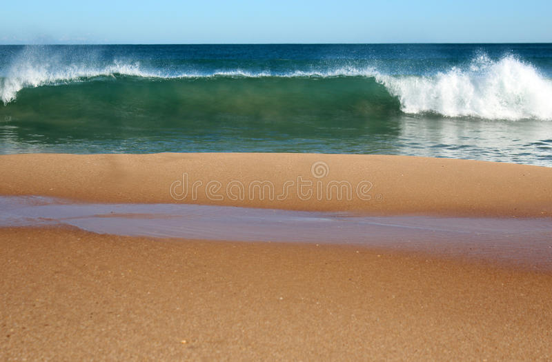 Indian Ocean waves rolling in at pristine Binningup Beach Western Australia on a sunny morning in late autumn. Indian Ocean waves rolling in at pristine stock photography
