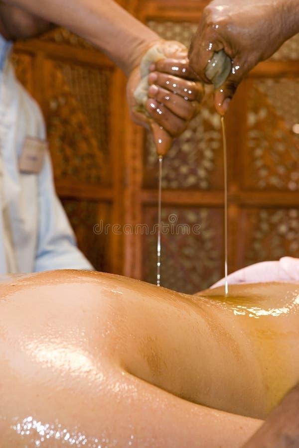 Indian oil body massage stock photo