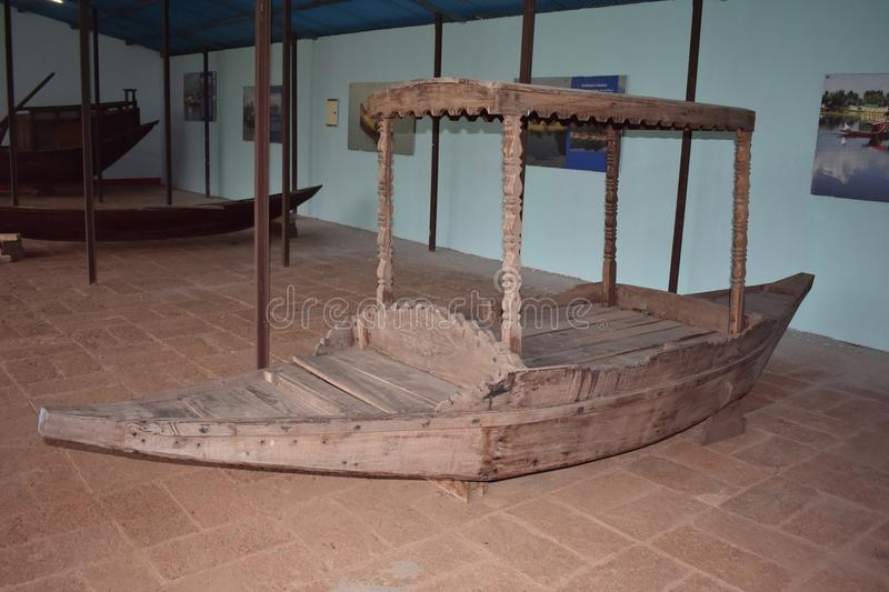 Indian old fishing boat The history of boats. Fisherman`s old fishing boat at Odisha state museum Cuttack, Odisha, India. Built from wood. In which the poor stock photo