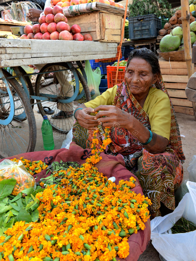 Indian Old Lady Sells Flower stock image
