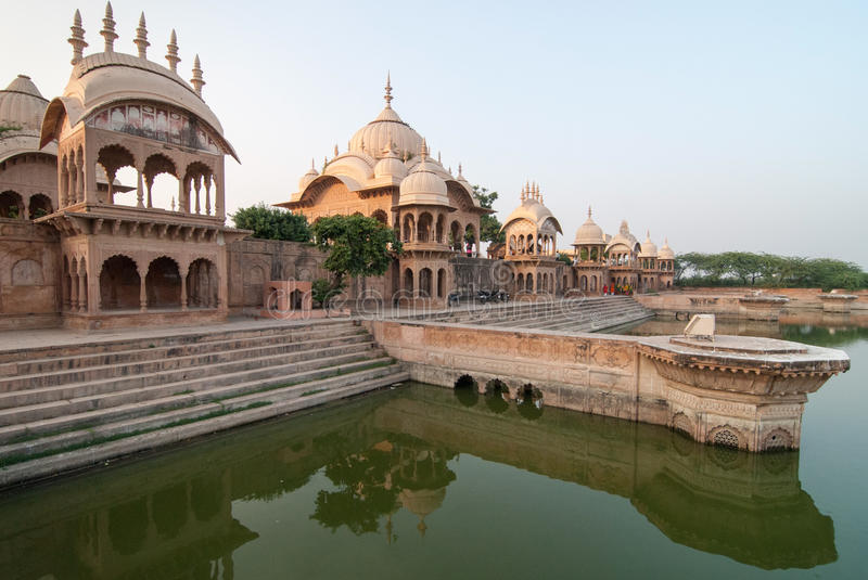 Indian palace. An Indian palace with a water tank against a clear sky. In the holy city of Govardhan near Mathura in North India stock photo