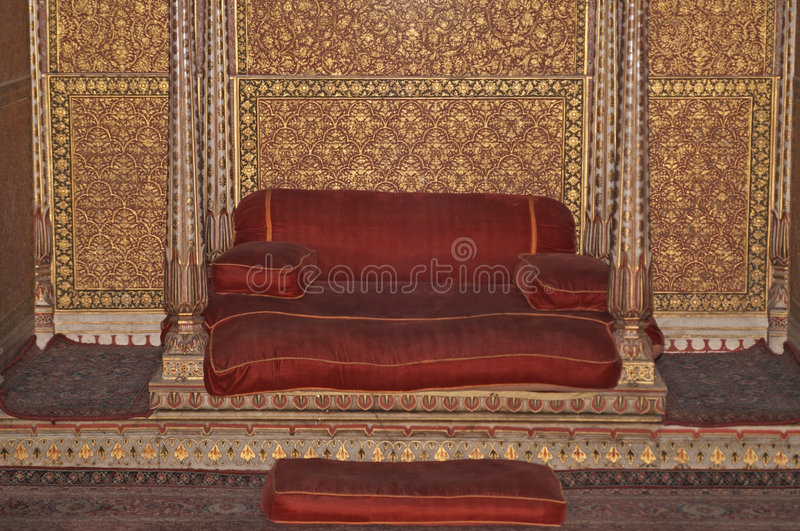 Indian Palace. Royal throne inside the ornately decorated audience chamber of an Indian Palace. Bikaner, Rajasthan royalty free stock photo