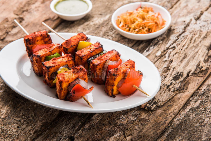 Indian paneer barbecue or tikka kabab. Paneer Tikka Kabab - Tandoori Indian cheese skewers, malai paneer tikka / malai paneer kabab, chilli paneer served in stock image