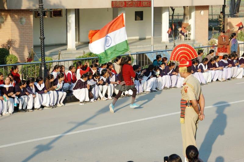 Indian people celebrating at the Indian - Pakistani border during daily border closing ceremony,Attari stock photo