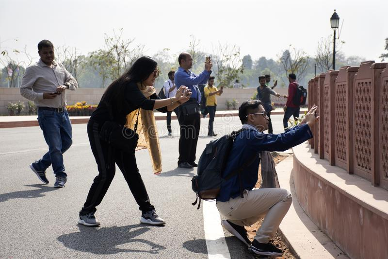 Indian people and foreign travelers use mobile phone and smartphone for shooting take photo india Gate War Memorial. At city of Delhi on March 17, 2019 in New royalty free stock image