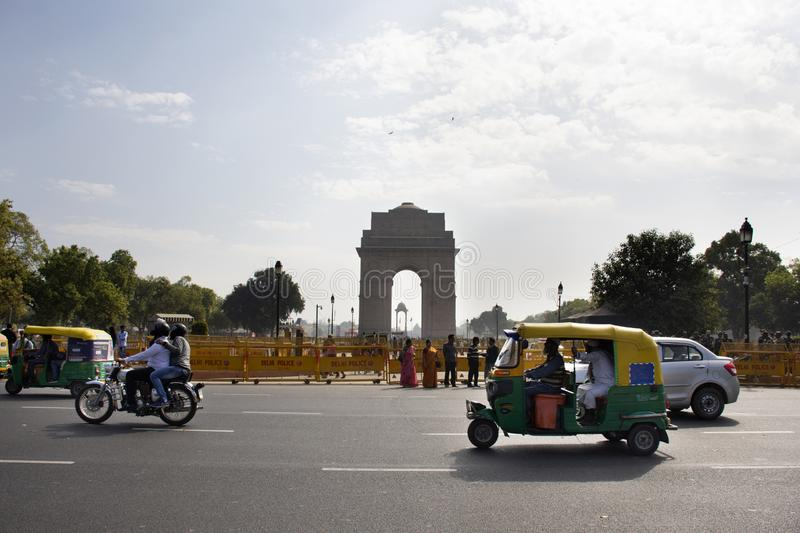 Indian people drive car and ride and bike and walk on street with traffic road at india Gate and War Memorial in New Delhi, India. Indian people and foreigners stock photo
