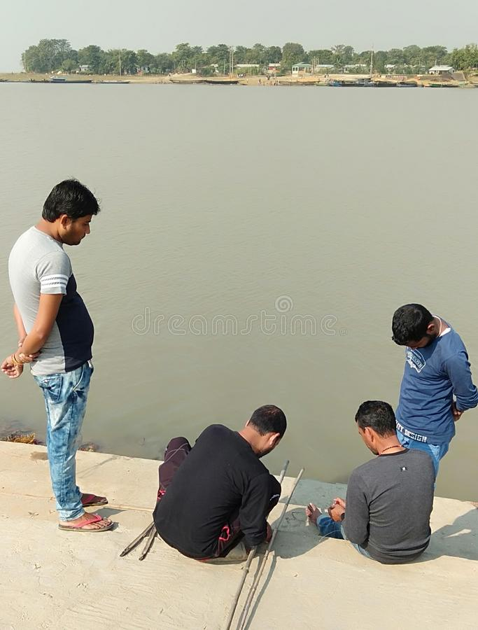 Indian people getting ready for fishing. Few indian people getting ready for fishing on the banks of river brahmaputra.here the Indian government has decided to royalty free stock photos