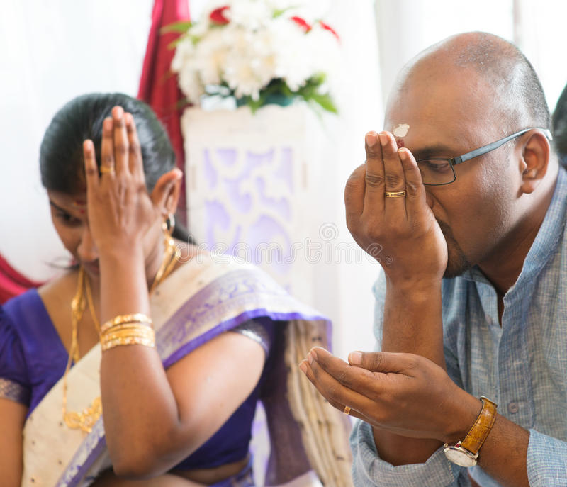 Indian people received prayers from priest stock photos