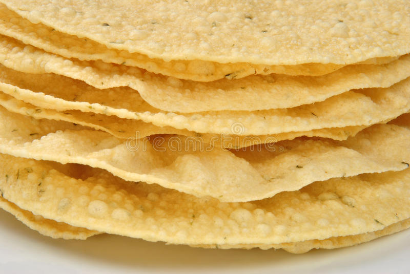 indian poppadoms on a white plate stock images