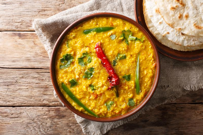 Indian popular food Dal Tadka Curry served with roti flatbread c. Lose-up on the table. horizontal top view from above royalty free stock photo