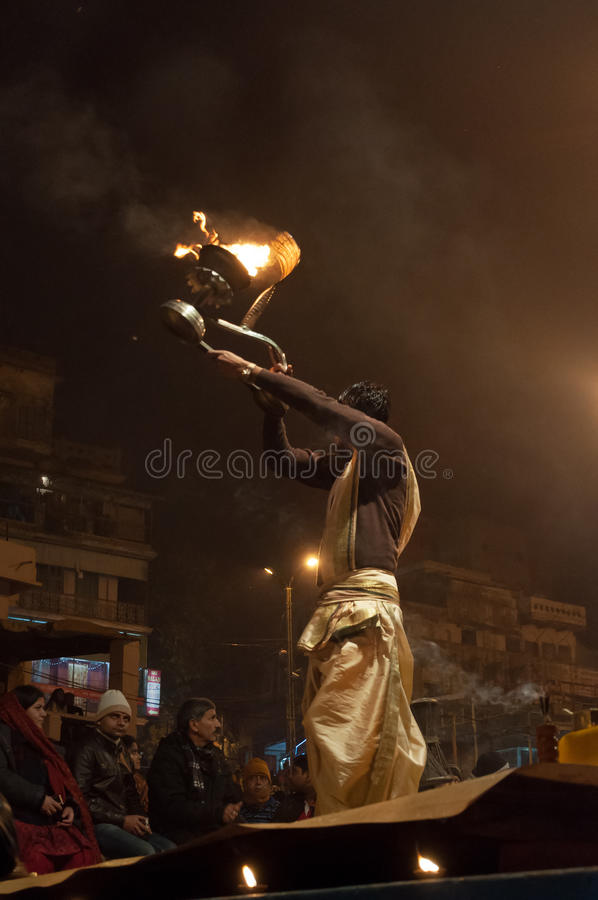 Indian priest performs religious Ganga Aarti ceremony or fire puja at Dashashwamedh Ghat in Varanasi. Uttar Pradesh. VARANASI, INDIA - DEC 23, 2014: Unidentified royalty free stock photography