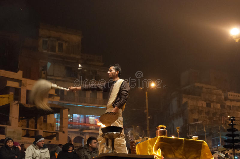 Indian priest performs religious Ganga Aarti ceremony or fire puja at Dashashwamedh Ghat in Varanasi. Uttar Pradesh. VARANASI, INDIA - DEC 23, 2014: Unidentified stock photography
