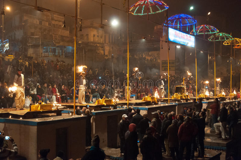Indian priests performs religious Ganga Aarti ceremony at Dashashwamedh Ghat in Varanasi. Uttar Pradesh. VARANASI, INDIA - DEC 23, 2014: Unidentified Indian stock photo