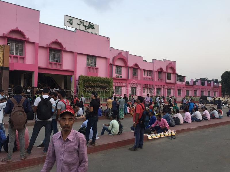 Indian Railway 🚃 station 🚉 looks beautiful in pink colour in bihar. Gather of lots of public inside the premises.Its a district named as Katihar royalty free stock images