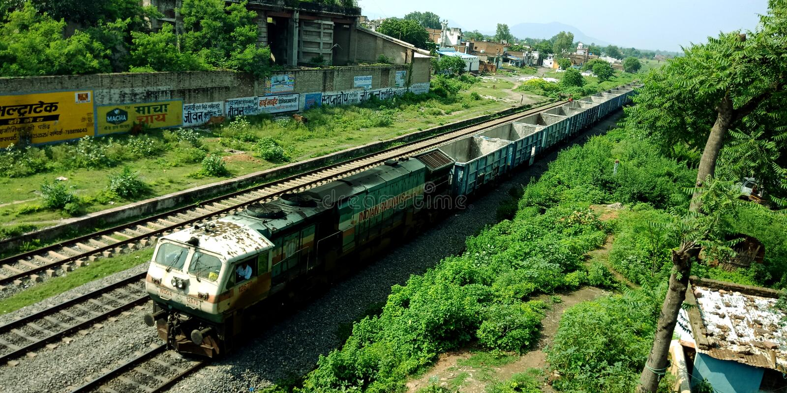 indian railway train crossing over bridge around forest area in India aug 2019 stock image