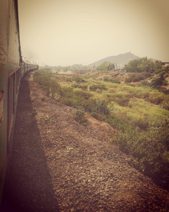 Indian railways. The rail keeps moving while it& x27;s still at the sane place ...one of the best and most beautiful source of travelling in india royalty free stock images