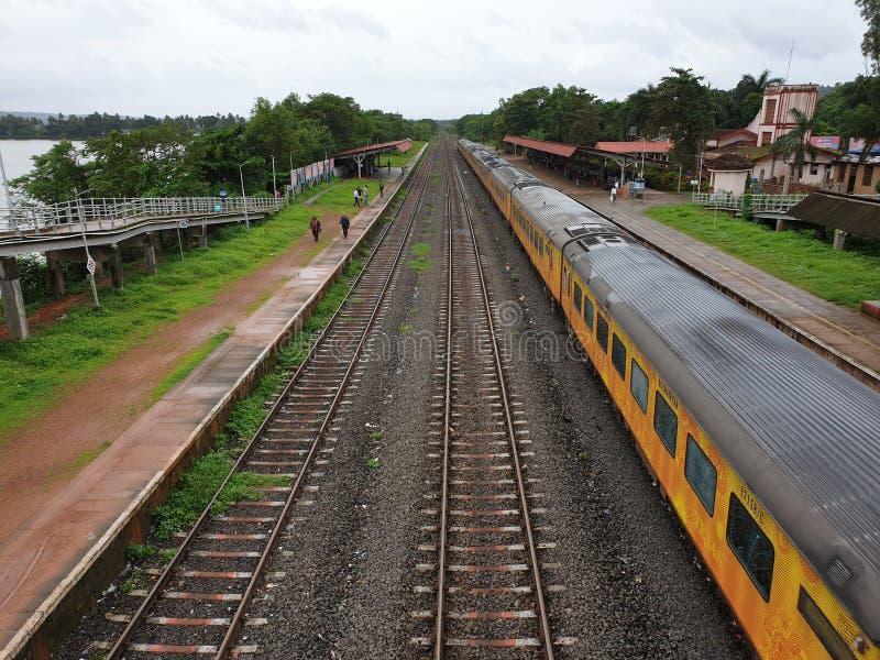 Indian Railways. Train, goa, karmali, tejas, track, travel, pickup, rainy, cloudy stock photos