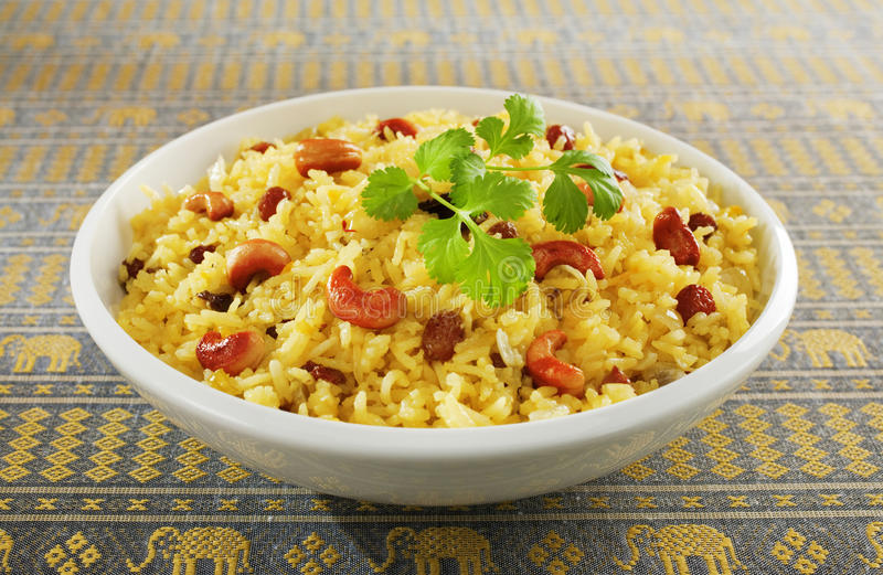 Indian Rice Pilau in White Bowl royalty free stock images