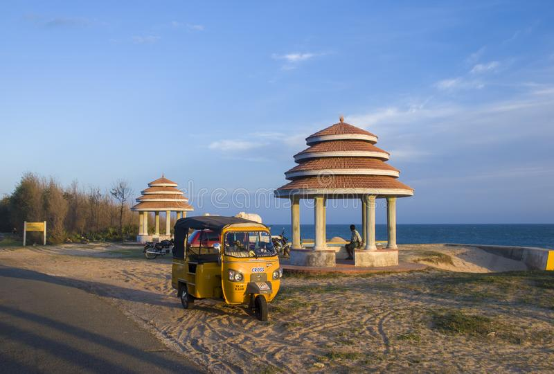 Indian Rickshaw in the southern coastline of India. Nagercoil, Tamil Nadu, India - October 16, 2010: Rickshaw parked at Sanguthurai Beach, one of the most royalty free stock image