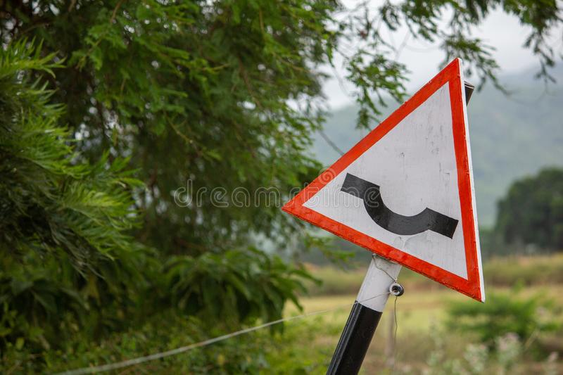 Indian road sign indicating dip ahead, Hasanur, Tamil Nadu, India. Hasanur is a town in Talamalai Reserve Forest in Tamil Nadu - Karnataka State border, India royalty free stock photography