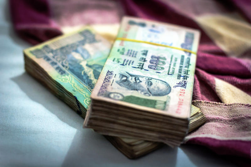 Indian rupee currency, money with blurry Indian blanket on background. stock photo