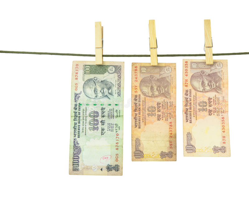 Indian Rupees Bank Notes. Money hanging on a clothes line royalty free stock photo