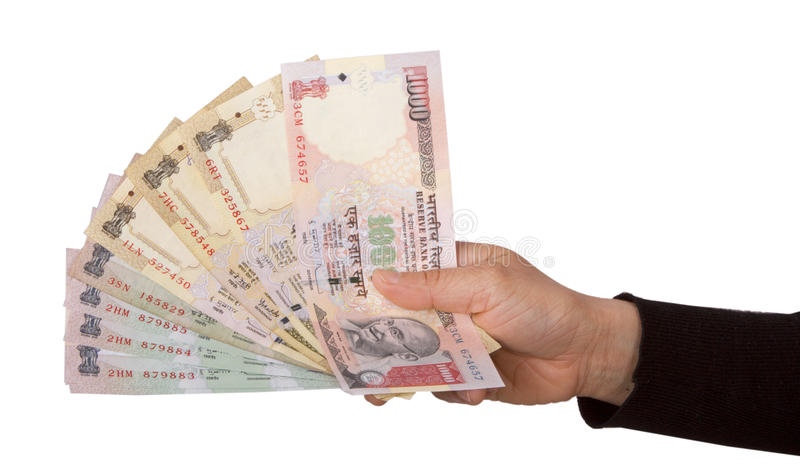 Indian rupees. Holding and giving Indian rupees to someone from purse royalty free stock photos