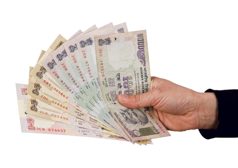 Indian rupees. Holding and giving Indian rupees to someone from purse royalty free stock photo