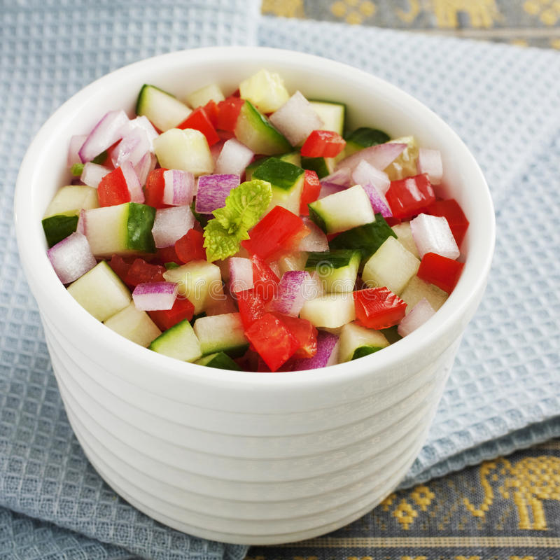 Indian Salad Kachumber. Indian curry accompaniment kachumber or cachumber, a salad made from cucumber, tomato, onion and chili royalty free stock photo