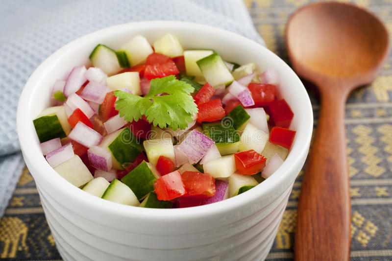Indian Salad Kachumber. Indian curry accompaniment kachumber or cachumber, a salad made from cucumber, tomato, onion and chili royalty free stock photography