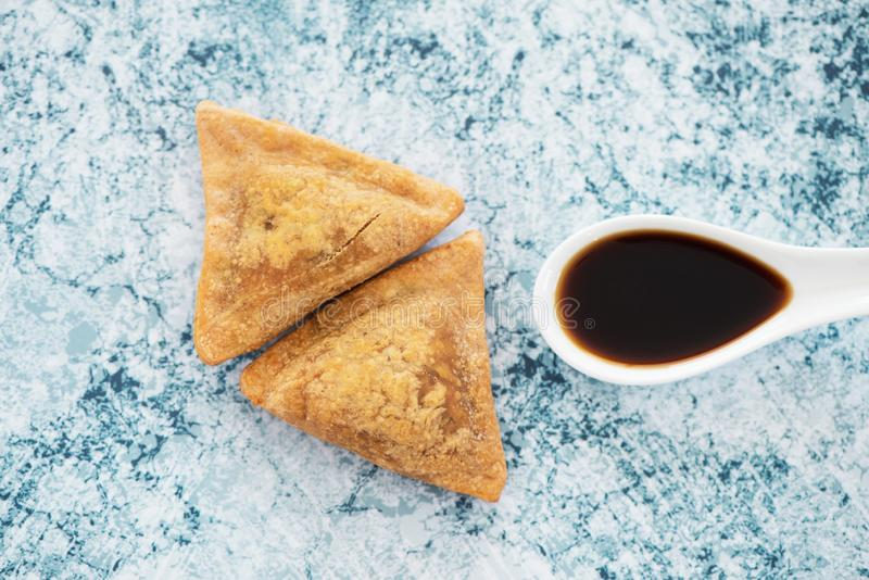 Indian samosas on a stone surface stock images