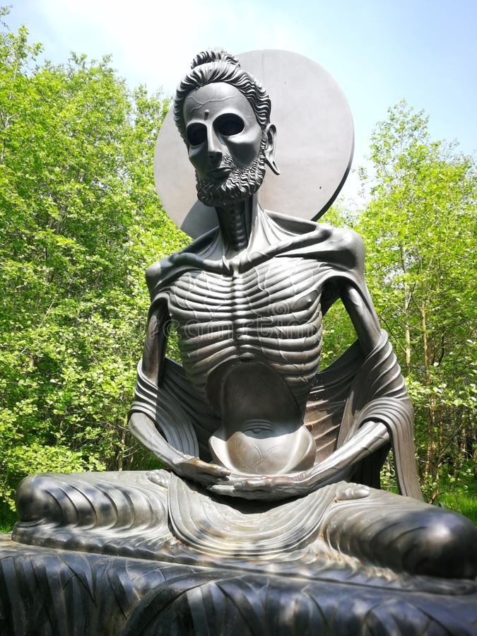 Indian statue death composition green royalty free stock photo