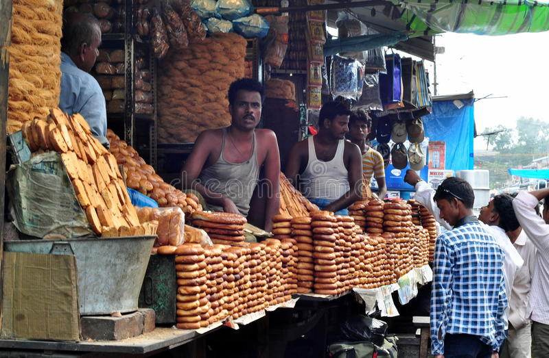 Indian shopkeeper. Selling cookies,biscuits in the city of Patna royalty free stock image