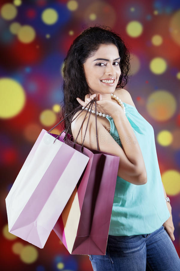Indian shopper with defocused background stock photography