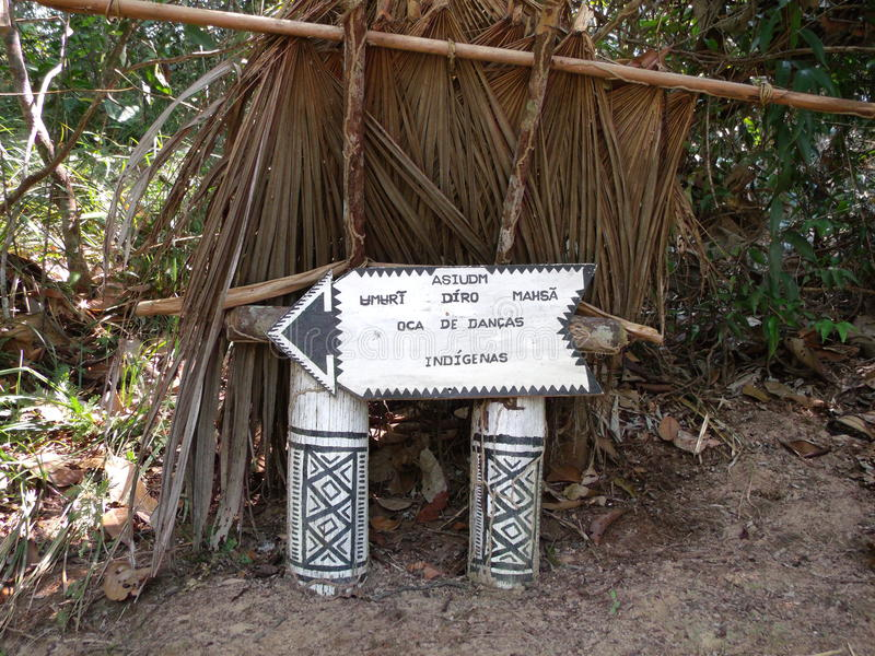 Sign of a Amazon native South American. The image shows a sign created by native Amazon native Americans to guide people to the indian dance tend, which is stock photos