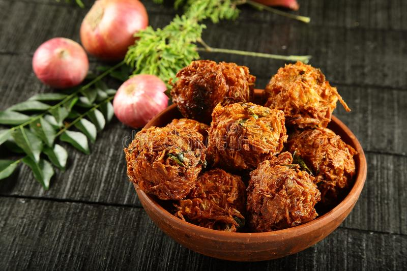 Indian snack onion fritters. Indian street snack onion pakoda or fritters stock photo