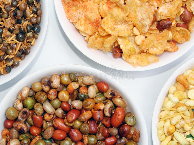 Indian snacks. Variety of indian snacks on white background stock photography